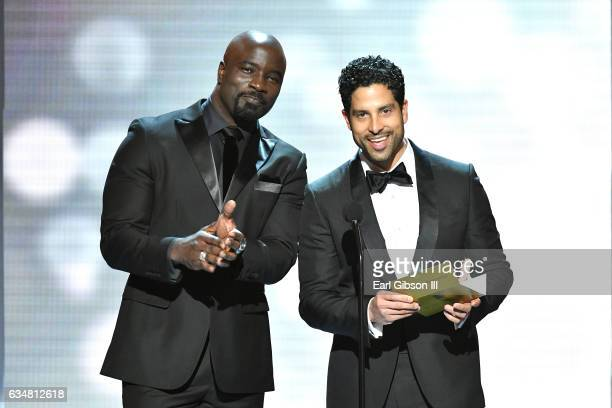 Actors Mike Colter and Adam Rodriguez onstage at the 48th NAACP Image Awards at Pasadena Civic Auditorium on February 11 2017 in Pasadena California