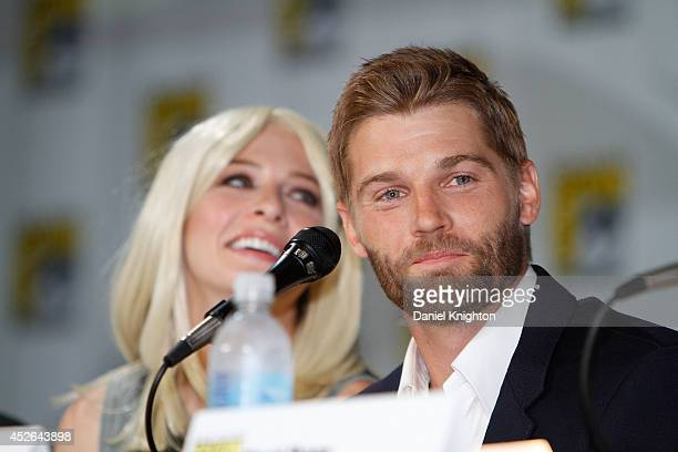 Actors Mike Vogel and Rachelle Lefevre attend the CBS 'Under The Dome' panel exclusive sneak preview during ComicCon International at San Diego...