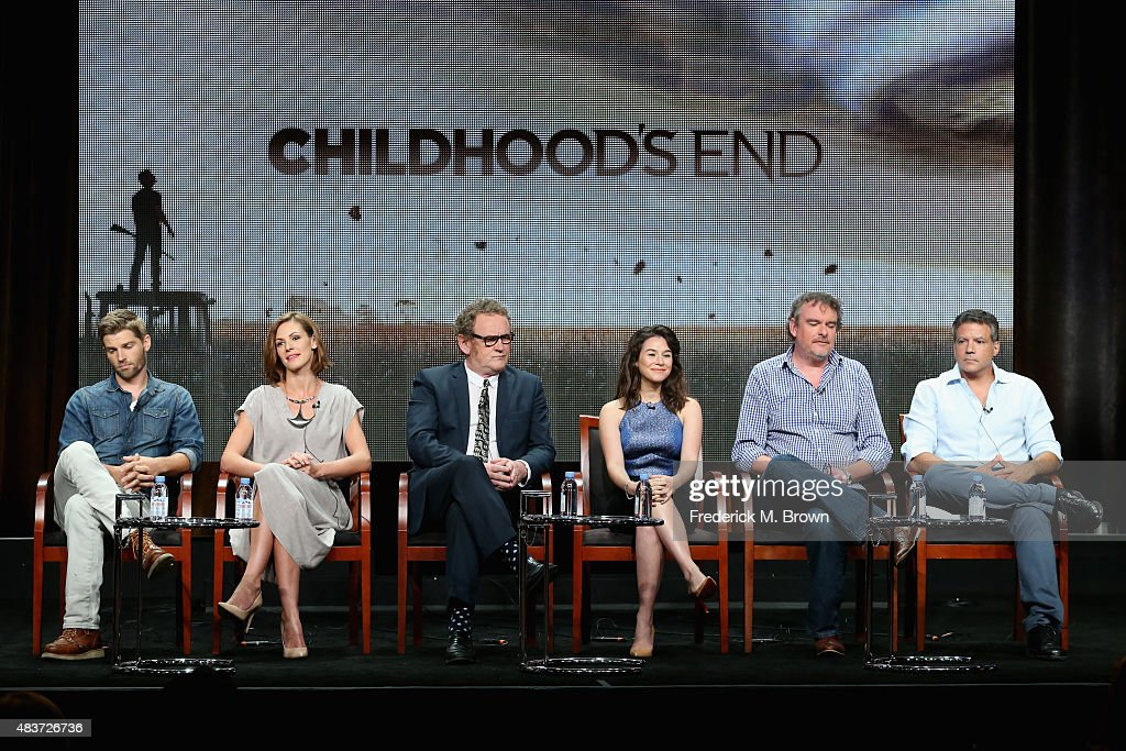 Actors Mike Vogel, Daisy Betts, Colm Meaney, Yael Stone, writer/executive producer Matthew Graham and executive producer Michael De Luca speak onstage during the Syfy Networks' 'Childhood's End' panel discussion at the NBCUniversal portion of the 2015 Summer TCA Tour at The Beverly Hilton Hotel on August 12, 2015 in Beverly Hills, California.