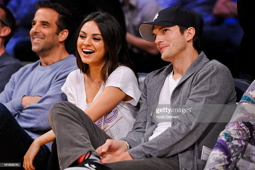 Actors Mila Kunis and Ashton Kutcher attend a game between the Phoenix Suns and the Los Angeles Lakers at Staples Center on February 12, 2013 in Los Angeles, California.