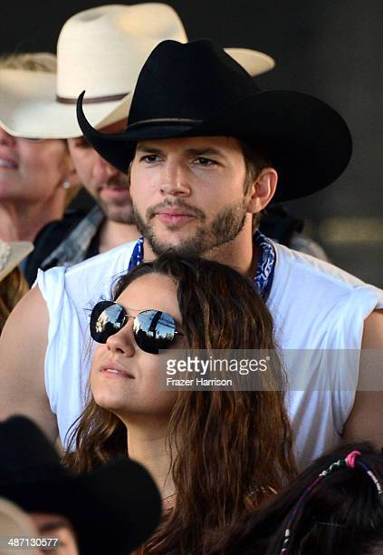 Actors Mila Kunis and Ashton Kutcher seen during day 3 of 2014 Stagecoach California's Country Music Festival at the Empire Polo Club on April 27...