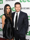 Actors Mila Kunis and Mark Wahlberg arrive at the Premiere of Universal Pictures' 'Ted' sponsored in part by AXE Hair at Grauman's Chinese Theatre on...