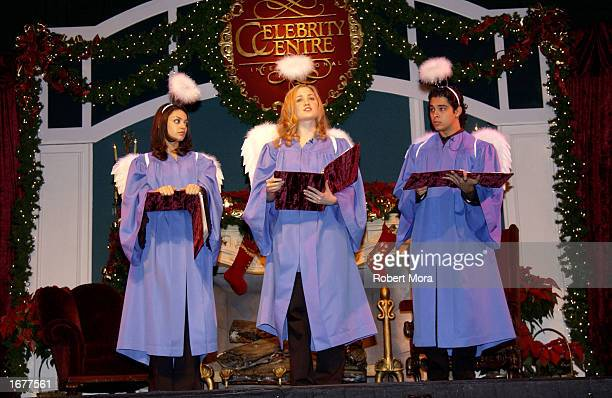 Actors Mila Kunis Erika Christensen and Wilmer Valderrama perform on stage at the Church of Scientology's fundraiser 'Christmas Stories X' to benefit...