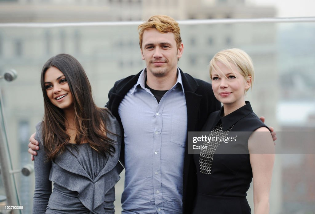 Actors <a gi-track='captionPersonalityLinkClicked' href=/galleries/search?phrase=Mila+Kunis&family=editorial&specificpeople=212845 ng-click='$event.stopPropagation()'>Mila Kunis</a>, <a gi-track='captionPersonalityLinkClicked' href=/galleries/search?phrase=James+Franco&family=editorial&specificpeople=577480 ng-click='$event.stopPropagation()'>James Franco</a> and Michelle Williams during a photocall before Walt Disney Pictures Moscow premiere of 'Oz The Great And Powerful' at the roof of Ritz hotel on February 27, 2013 in Moscow, Russia.