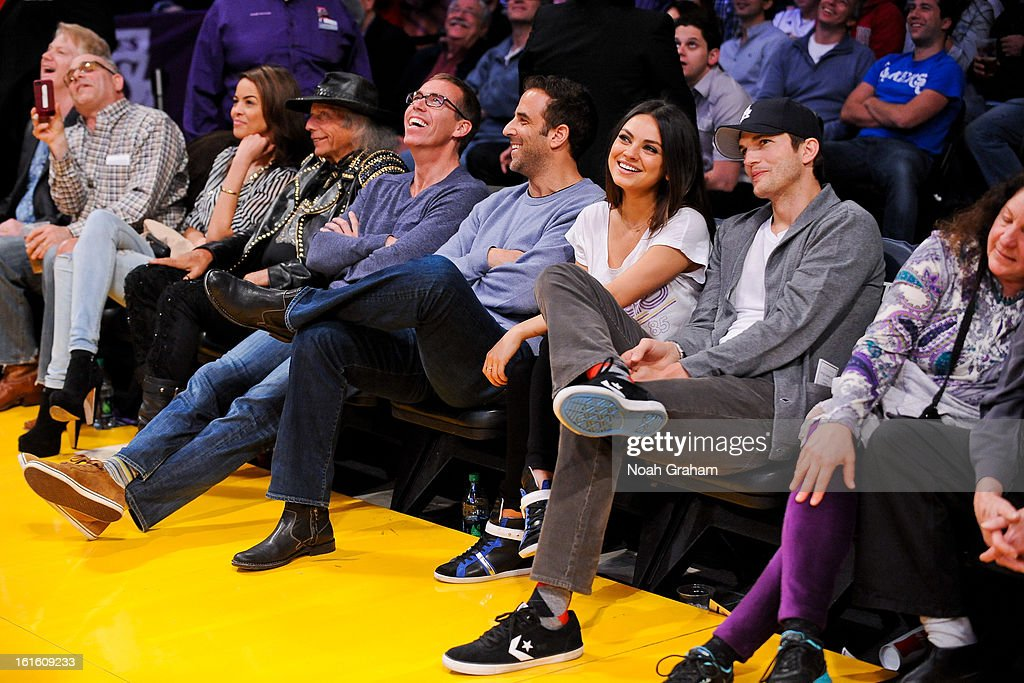 Actors Mila Kunis, second right, and Ashton Kutcher, right, attend a game between the Phoenix Suns and the Los Angeles Lakers at Staples Center on February 12, 2013 in Los Angeles, California.