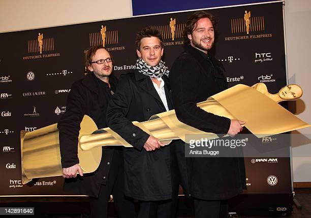 Actors Milan Peschel Peter Schneider and Ronald Zehrfeld attend the nominees reception of the 'Deutscher Filmpreis' award on April 14 2012 in Berlin...