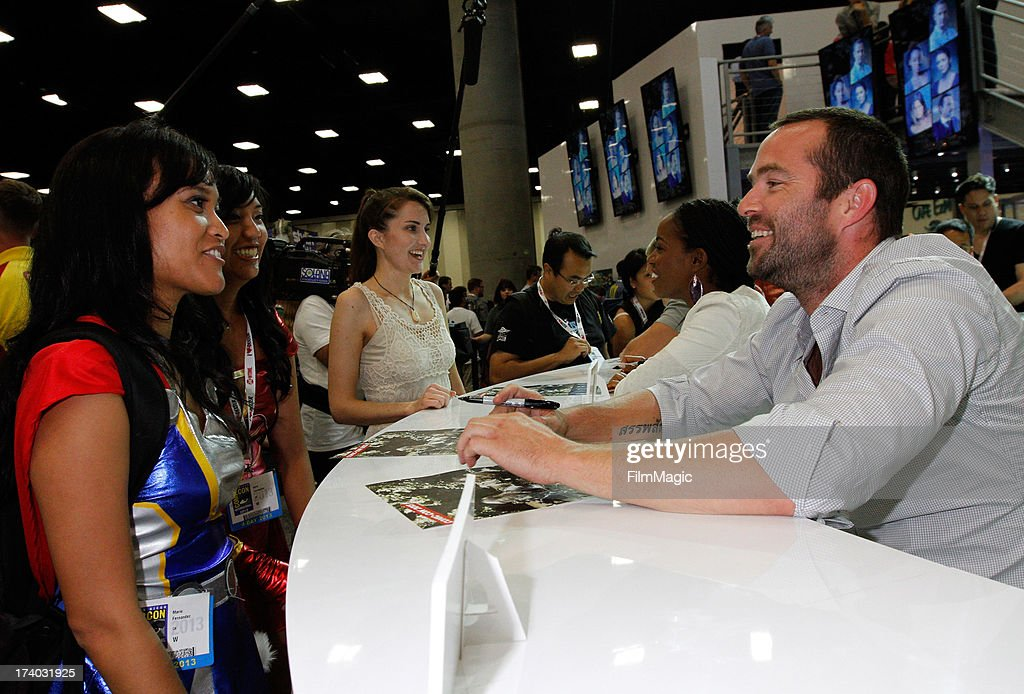 Actors Milauna Jackson and Sullivan Stapleton attend Cinemax's 'Strike Back' cast autograph signing at San Diego Convention Center on July 19, 2013 in San Diego, California.