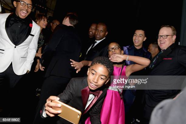 Actors Miles Brown Marsai Martin and Marcus Scribner of Blackish take a selfie during the 48th NAACP Image Awards at Pasadena Civic Auditorium on...