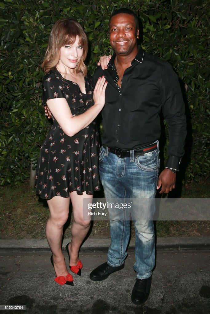 Actors Milla Jovovich (L) and Chris Tucker attend Cinespia Presents 'The Fifth Element' at Hollywood Forever on July 15, 2017 in Hollywood, California.