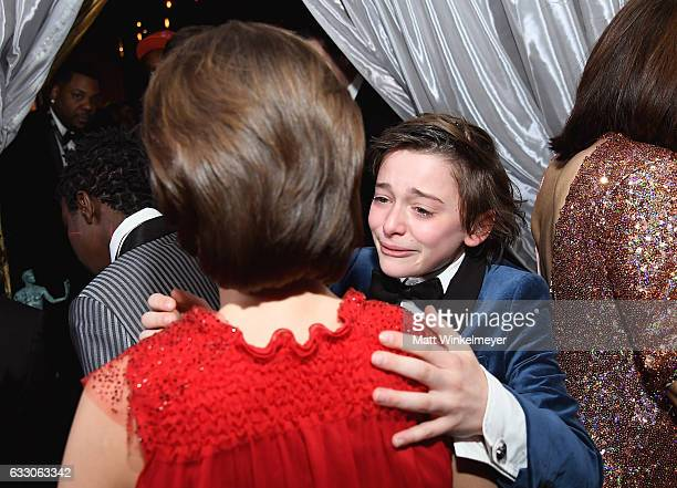 Actors Millie Bobby Brown and Noah Schnapp hug backstage after winning the award for the Outstanding Ensemble in a Drama Series award for 'Stranger...