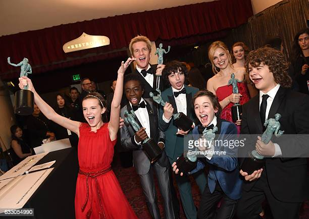 Actors Millie Bobby Brown Caleb McLaughlin Matthew Modine Finn Wolfhard Noah Schnapp Cara Buono and Gaten Matarazzo winners of the Outstanding...