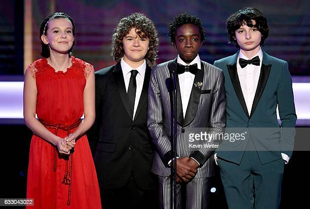 Actors Millie Bobby Brown Gaten Matarazzo Caleb McLaughlin and Finn Wolfhard speak onstage during The 23rd Annual Screen Actors Guild Awards at The...