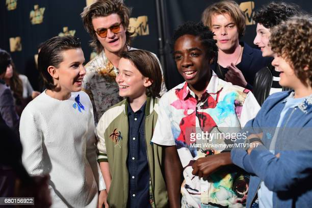 Actors Millie Bobby Brown Joe Keery Noah Schnapp Caleb McLaughlin Charlie Heaton Finn Wolfhard and Gaten Matarazzo attend the 2017 MTV Movie And TV...