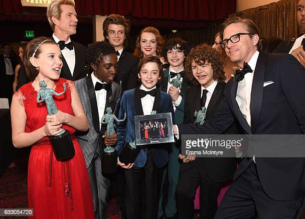 Actors Millie Bobby Brown Matthew Modine Caleb McLaughlin Joe Keery Shannon Purser Noah Schnapp Finn Wolfhard and Gaten Matarazzo winners of the...