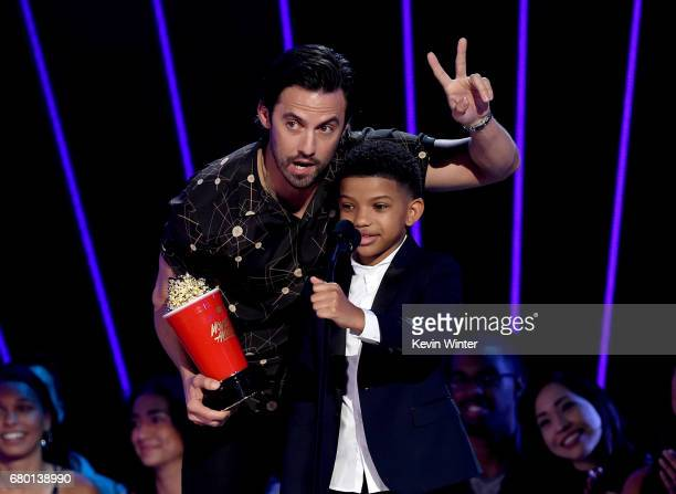 Actors Milo Ventimiglia and Lonnie Chavis accept the Tearjerker award for 'This Is Us' onstage during the 2017 MTV Movie And TV Awards at The Shrine...