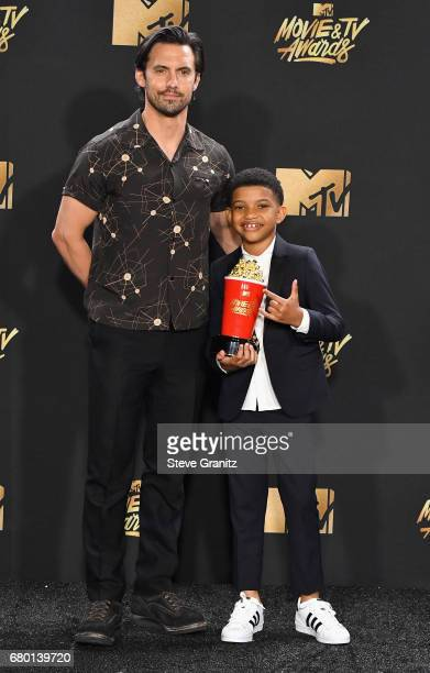 Actors Milo Ventimiglia and Lonnie Chavis pose with the Tearjerker award for 'This Is Us' in the press room at the 2017 MTV Movie and TV Awards at...