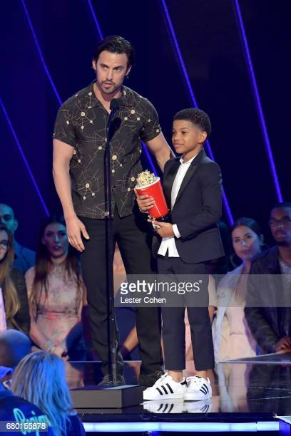 Actors Milo Ventimiglia and Lonnie Chavis winners of the Tearjerker award for 'This Is Us' accept award onstage during the 2017 MTV Movie And TV...