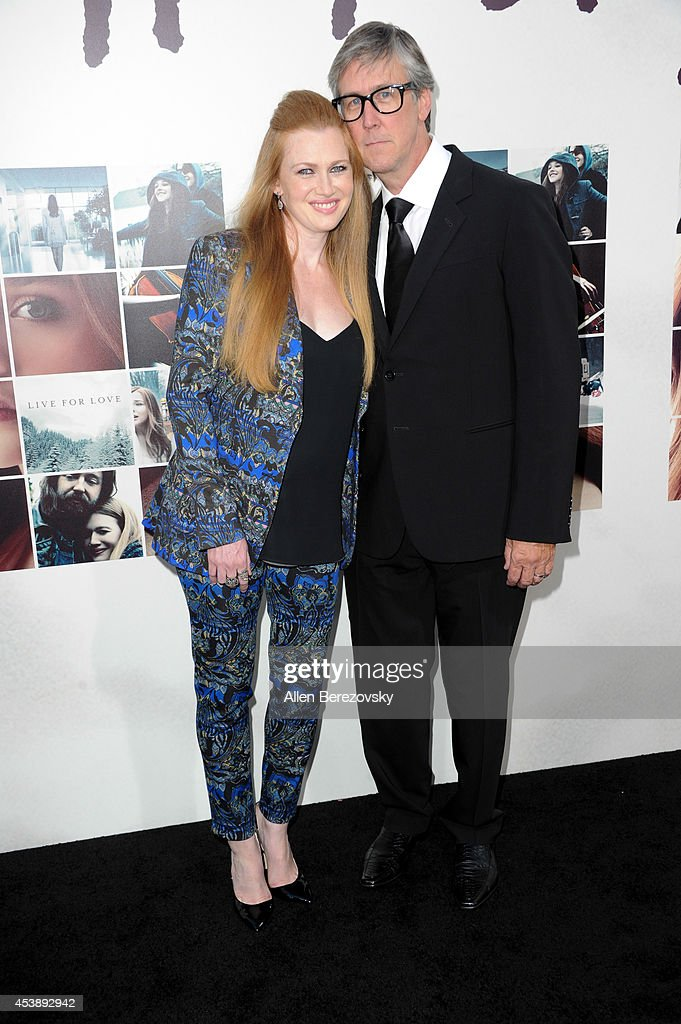 Actors Mireille Enos and Alan Ruck arrive at the Los Angeles Premiere of 'If I Stay' at TCL Chinese Theatre on August 20 2014 in Hollywood California