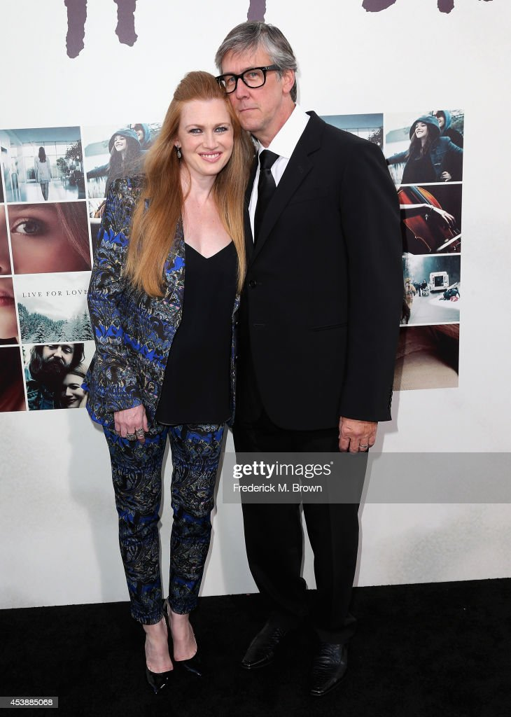 Actors Mireille Enos and Alan Ruck (R) attend the Premiere of New Line Cinema's and Metro-Goldwyn-Mayer Pictures' 'If I Stay' at TCL Chinese Theatre on August 20, 2014 in Hollywood, California.