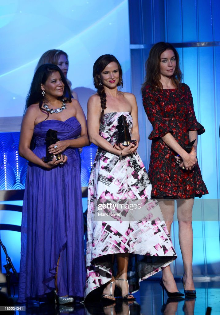 Actors <a gi-track='captionPersonalityLinkClicked' href=/galleries/search?phrase=Misty+Upham&family=editorial&specificpeople=4835047 ng-click='$event.stopPropagation()'>Misty Upham</a>, <a gi-track='captionPersonalityLinkClicked' href=/galleries/search?phrase=Juliette+Lewis&family=editorial&specificpeople=202873 ng-click='$event.stopPropagation()'>Juliette Lewis</a> and <a gi-track='captionPersonalityLinkClicked' href=/galleries/search?phrase=Julianne+Nicholson&family=editorial&specificpeople=757237 ng-click='$event.stopPropagation()'>Julianne Nicholson</a> accept the Hollywood Ensemble Cast Award for 'August: Osage County,' as director John Wells and presenter Garry Marshall look on, onstage during the 17th annual Hollywood Film Awards at The Beverly Hilton Hotel on October 21, 2013 in Beverly Hills, California.