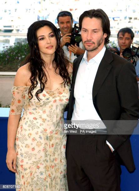 Actors Monica Bellucci and Keanu Reeves pose for photographers during a photocall to promote their new film The Matrix Reloaded at the Palias des...