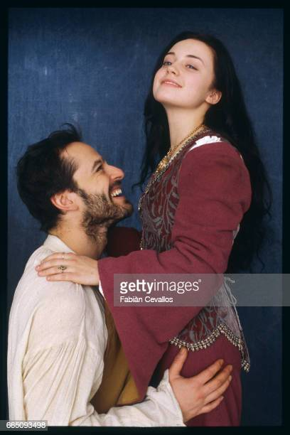 Actors Monica Keena and Gil Bellows smile and embrace each other on the set of the movie Snow White A Tale of Terror Directed by Michael Cohn this...