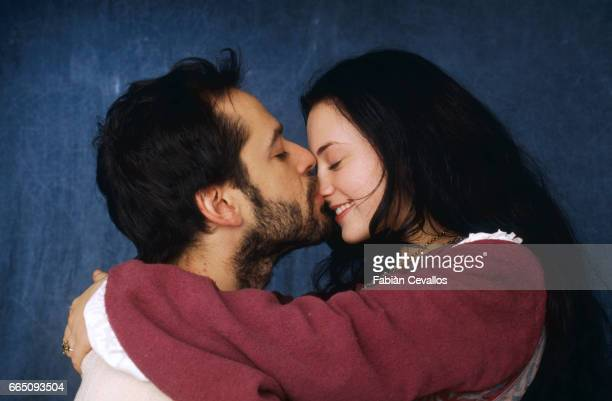 Actors Monica Keena and Gil Bellows smile and kiss on the set of the movie Snow White A Tale of Terror Directed by Michael Cohn this movie tells the...