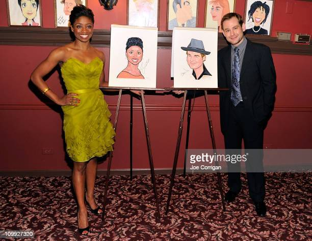 Actors Montego Glover and Chad Kimball attend their caricature unveiling for Broadway's 'Memphis' at Sardi's on March 10 2011 in New York City
