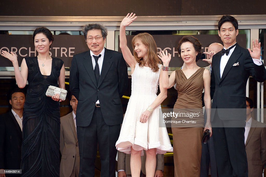 Actors Moon So-ri, director Sang-soo Hong, <a gi-track='captionPersonalityLinkClicked' href=/galleries/search?phrase=Isabelle+Huppert&family=editorial&specificpeople=662796 ng-click='$event.stopPropagation()'>Isabelle Huppert</a>, Youn Yuh-jung and Yu Jun-Sang attend 'Da-reun Na-ra-e-suh' Premiere during the 65th Annual Cannes Film Festival at Palais des Festivals on May 21, 2012 in Cannes, France.