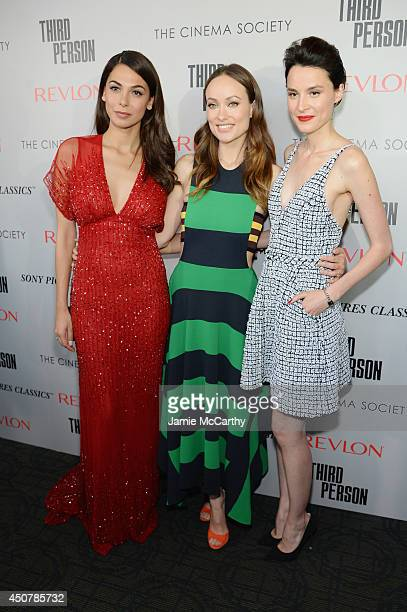 Actors Moran Atias Olivia Wilde and Loan Chabanol attend The Cinema Society Revlon screening of Sony Pictures Classics' 'Third Person' on June 17...