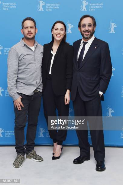 Actors Moritz Bleibtreu Antje Traue and director Sam Garbarski attend the 'Bye Bye Germany' photo call during the 67th Berlinale International Film...