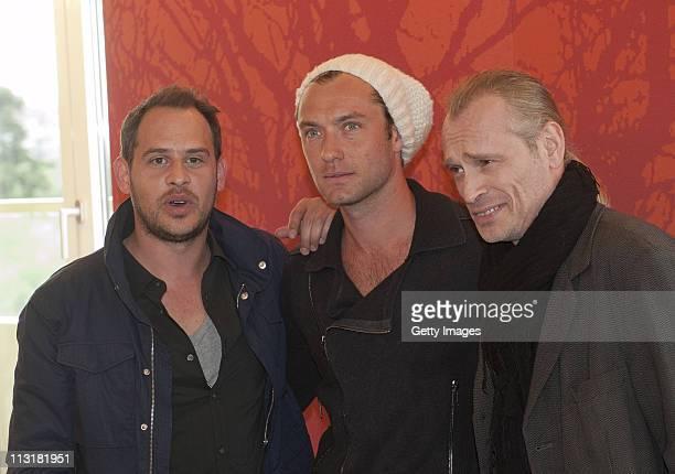 Actors Moritz Bleibtreu Jude Law and Johannes Krisch attend the 360 Vienna photocall at Hotel Savoyen on April 26 2011 in Vienna Austria