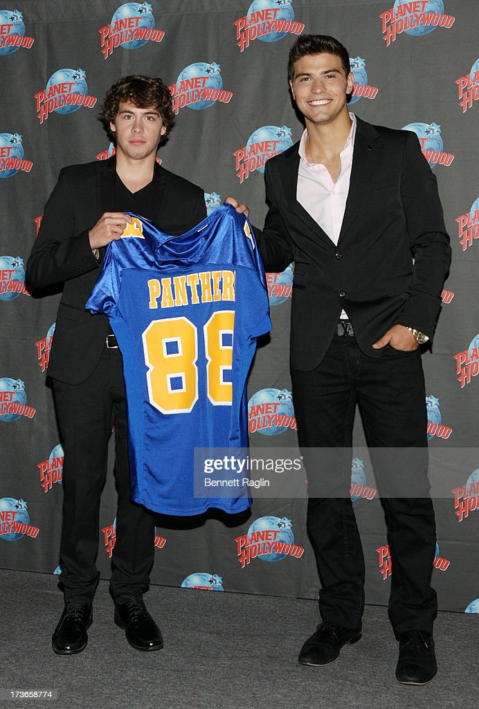 Actors Munro Chambers and Luke Bilyk visit at Planet Hollywood Times Square on July 16, 2013 in New York City.