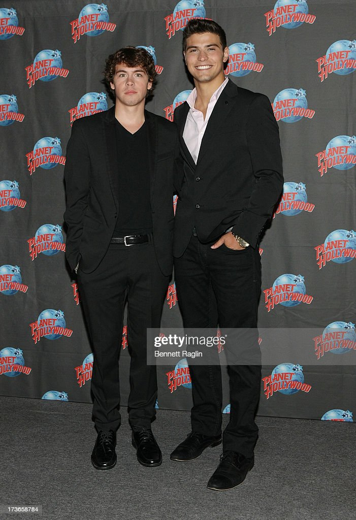 Actors Munro Chambers and Luke Bilyk visits at Planet Hollywood Times Square on July 16, 2013 in New York City.
