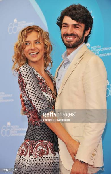 Actors Myriam Catania and Luca Argentero attends the 'Guglielmo Biraghi Awards' photocall at the Piazzale del Casino during the 65th Venice Film...