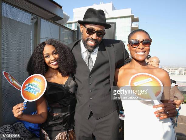 Actors Nafessa Williams Cress Williams and Chistine Adams at BuzzFeed The CW Present SRSLY The Best Damn Superhero Party on July 21 2017 in San Diego...