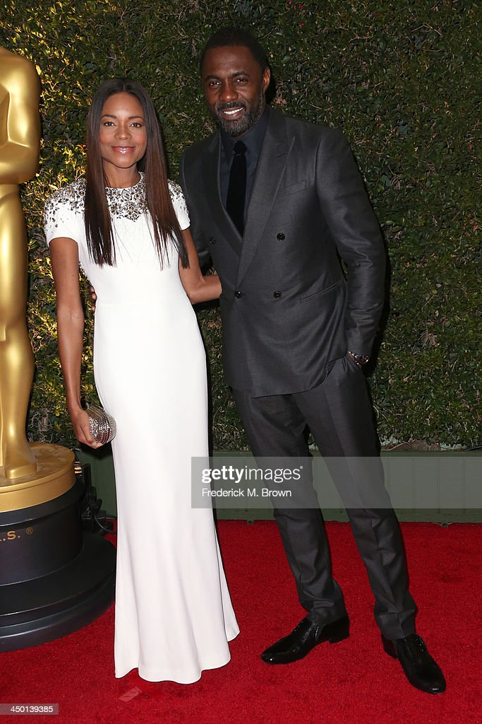 Actors <a gi-track='captionPersonalityLinkClicked' href=/galleries/search?phrase=Naomie+Harris&family=editorial&specificpeople=238918 ng-click='$event.stopPropagation()'>Naomie Harris</a> and <a gi-track='captionPersonalityLinkClicked' href=/galleries/search?phrase=Idris+Elba&family=editorial&specificpeople=215443 ng-click='$event.stopPropagation()'>Idris Elba</a> arrive at the Academy of Motion Picture Arts and Sciences' Governors Awards at The Ray Dolby Ballroom at Hollywood & Highland Center on November 16, 2013 in Hollywood, California.