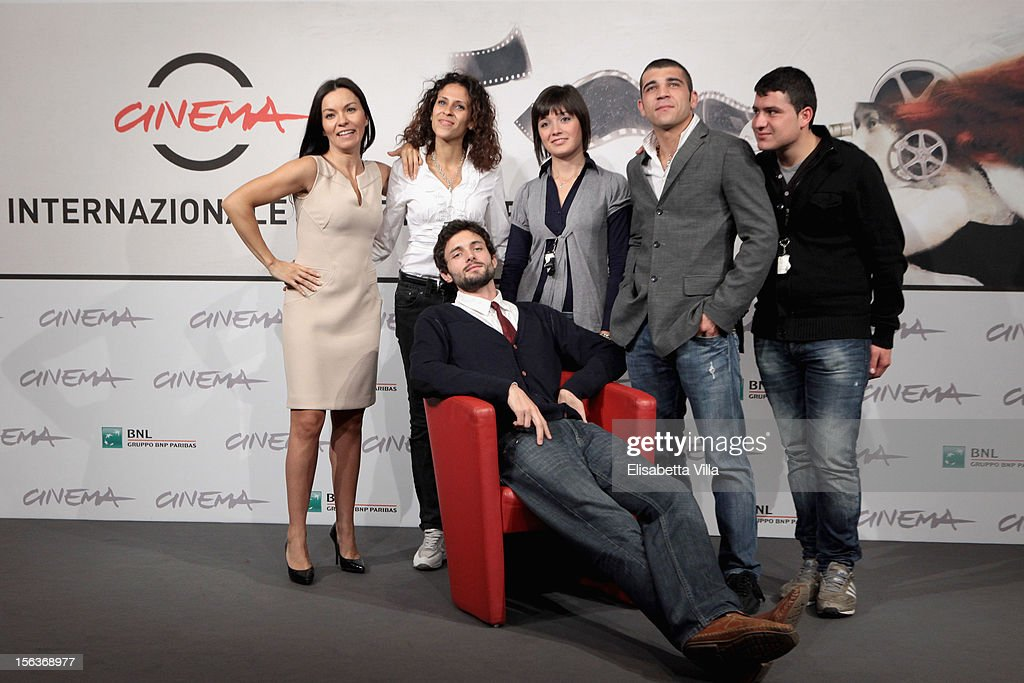 actors Narimen Cardia, Maria Benkhalouk, Elisa Pennisi, Enrico Toscano, Marco Pagliaro (front row) and director Joel Stangle attend the 'Acqua Fuori Dal Ring/La Prima Legge Di Newton' Photocall during the 7th Rome Film Festival at the Auditorium Parco Della Musica on November 14, 2012 in Rome, Italy.