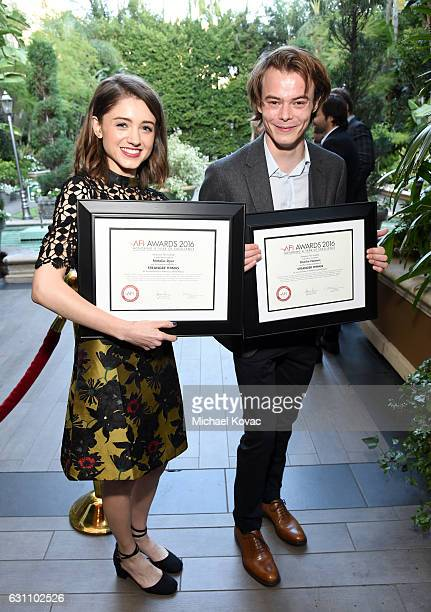 Actors Natalia Dyer and Charlie Heaton pose with awards during the 17th annual AFI Awards at Four Seasons Los Angeles at Beverly Hills on January 6...
