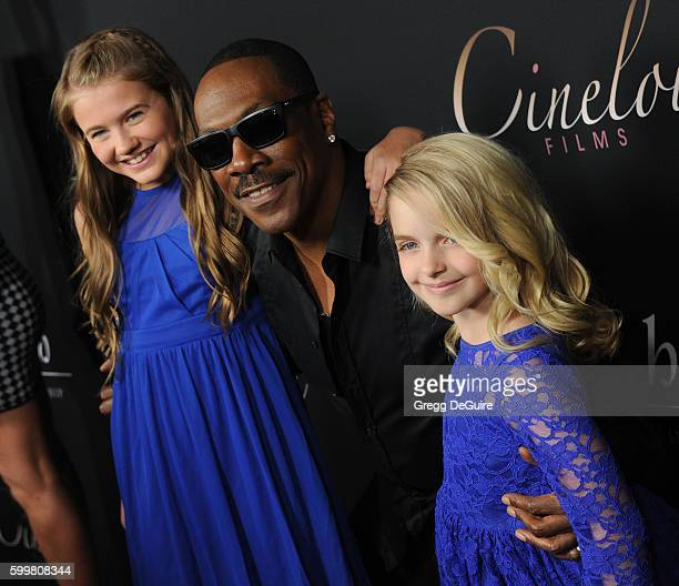 Actors Natalie Coughlin Eddie Murphy and Mckenna Grace arrive at the premiere of Cinelou Releasing's 'Mr Church' at ArcLight Hollywood on September 6...