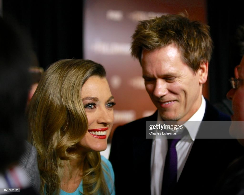 Actors Natalie Zea and Kevin Bacon attend 'The Following' premiere at The New York Public Library on January 18, 2013 in New York City.