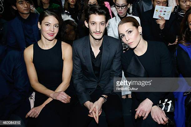 Actors Natasha Andrews her companion Pierre Niney and Noomi Rapace attend the Dior Homme Menswear Fall/Winter 20152016 Show as part of Paris Fashion...