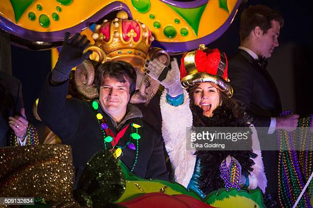 Actors Nathan Fillion and Krista Allen ride in the Krewe of Orpheus parade on February 8 2016 in New Orleans Louisiana