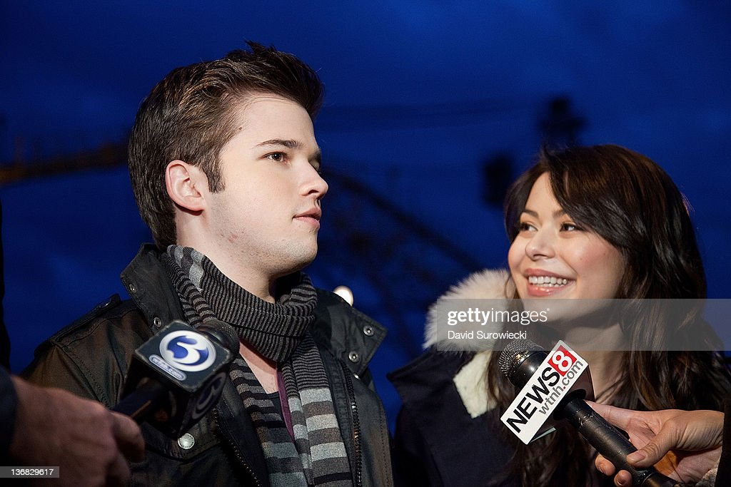 Actors Nathan Kress and Miranda Cosgrove talk to the press at Naval Submarine Base New London on January 11, 2012 in Groton, Connecticut. The cast of Nickelodeon's iCarly were presenting a special military family screening of iMeet The First Lady, an episode of their show featuring Michelle Obama.