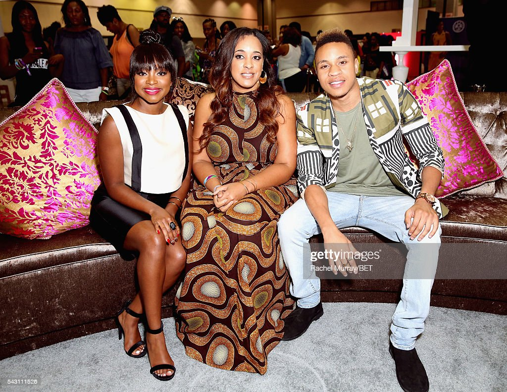 Actors Naturi Naughton (L) and Rotimi Akinosho (R) pose with a fan at Fashion And Beauty @BETX presented by Progressive, Covergirl, Strength of Nature, Korbel and Macy's during the 2016 BET Experience on June 25, 2016 in Los Angeles, California.