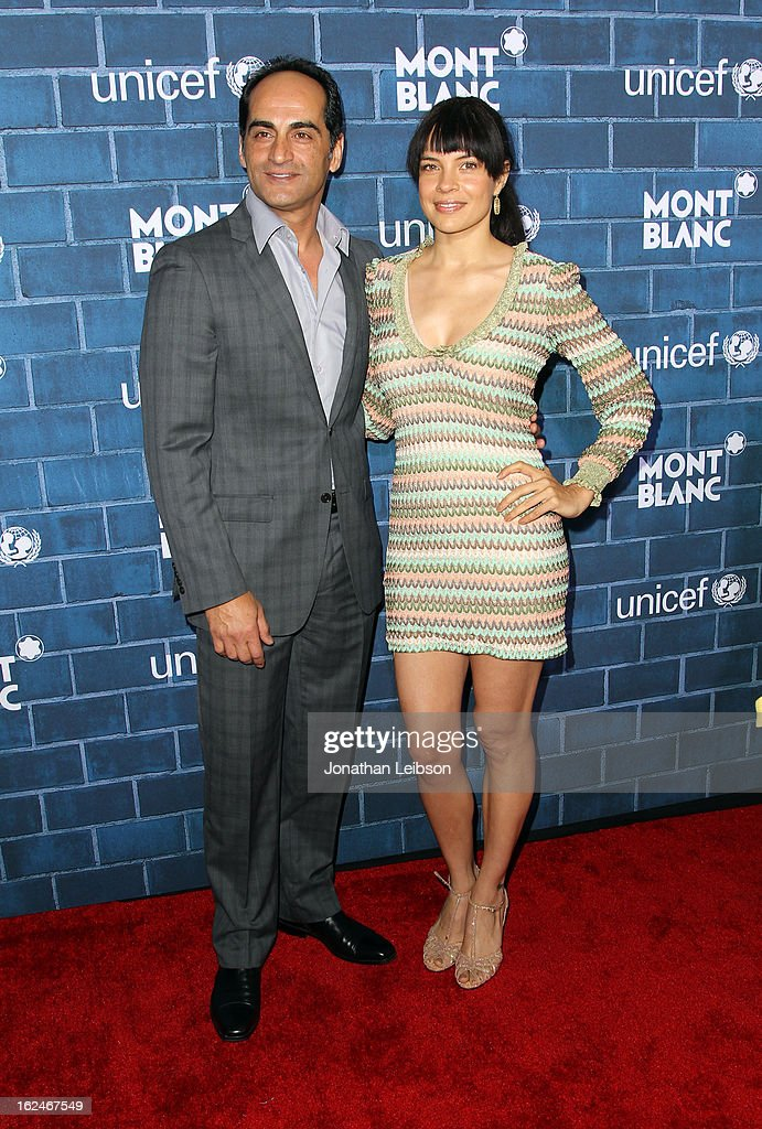 Actors Navid Negahban and Zuleikha Robinson attend a Pre-Oscar charity brunch hosted by Montblanc and UNICEF to celebrate the launch of their new 'Signature For Good 2013' Initiative with special guest Hilary Swank at Hotel Bel-Air on February 23, 2013 in Los Angeles, California.