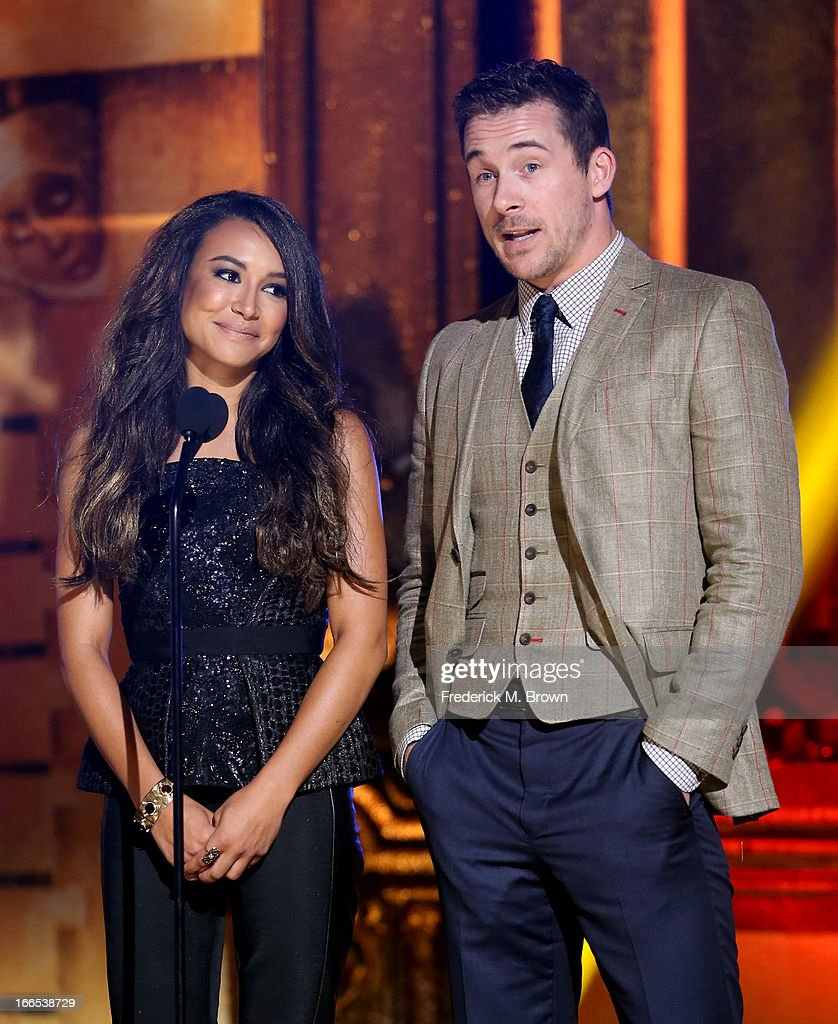 Actors Naya Rivera (L) and Barry Sloane speak onstage during the 2013 NewNowNext Awards at The Fonda Theatre on April 13, 2013 in Los Angeles, California.