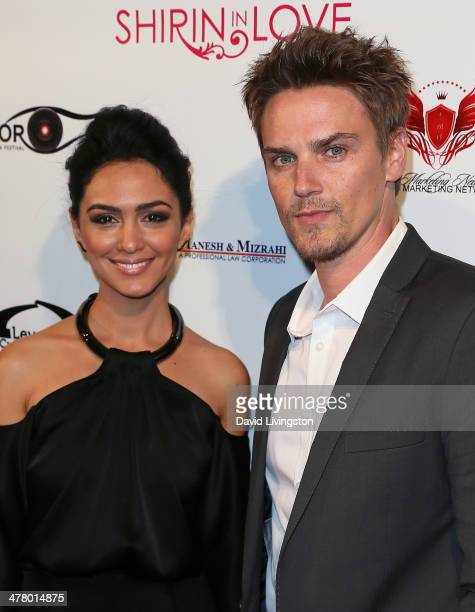 Actors Nazanin Boniadi and Riley Smith attend the premiere of Sideshow Releasing's 'Shirin In Love' at Avalon on March 11 2014 in Hollywood California