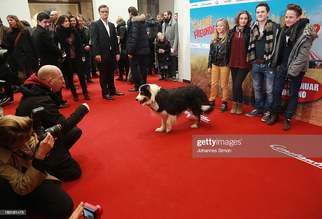 Actors Neele Marie Nickel, Valeria Eisenbart, Quirin Oettl and Justus Schlingensiepen and dog Coffey and dog coach Gordon Krei (on the left side) attend the 'Fuenf Freunde 2' movie premiere at CineMaxx Cinema on January 27, 2013 in Munich, Germany.