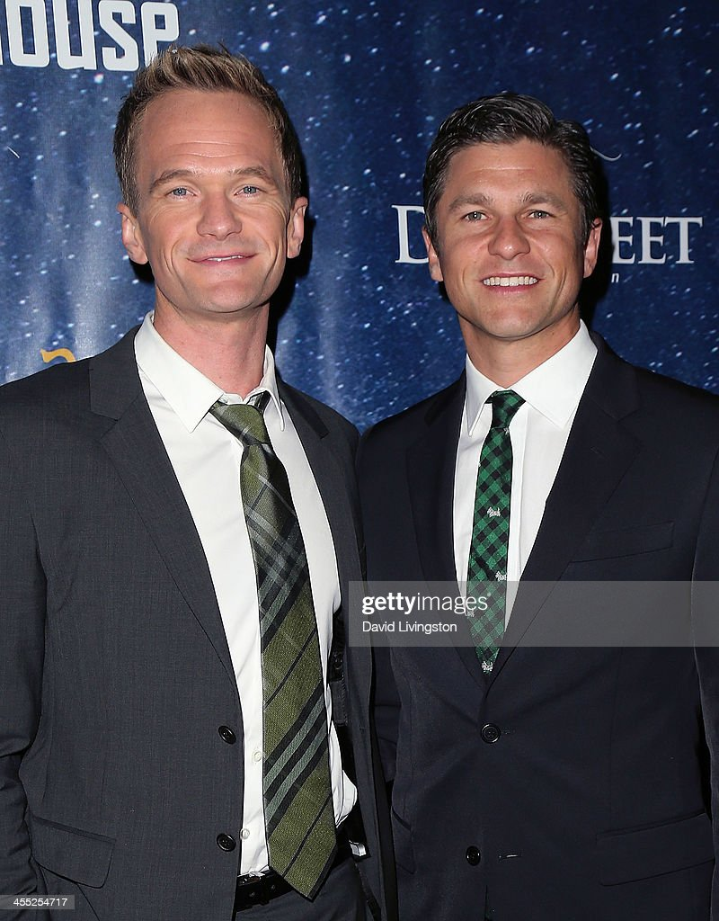 Actors <a gi-track='captionPersonalityLinkClicked' href=/galleries/search?phrase=Neil+Patrick+Harris&family=editorial&specificpeople=210509 ng-click='$event.stopPropagation()'>Neil Patrick Harris</a> (L) and <a gi-track='captionPersonalityLinkClicked' href=/galleries/search?phrase=David+Burtka&family=editorial&specificpeople=572242 ng-click='$event.stopPropagation()'>David Burtka</a> attend 'Aladdin and His Winter Wish' opening night at the Pasadena Playhouse on December 11, 2013 in Pasadena, California.